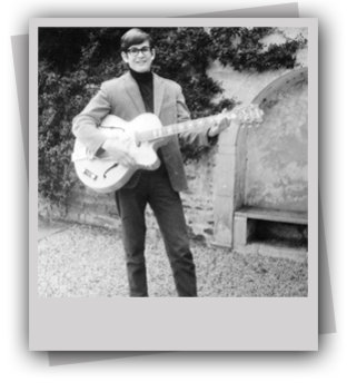 Photo of Richard Woolley with guitar 1965